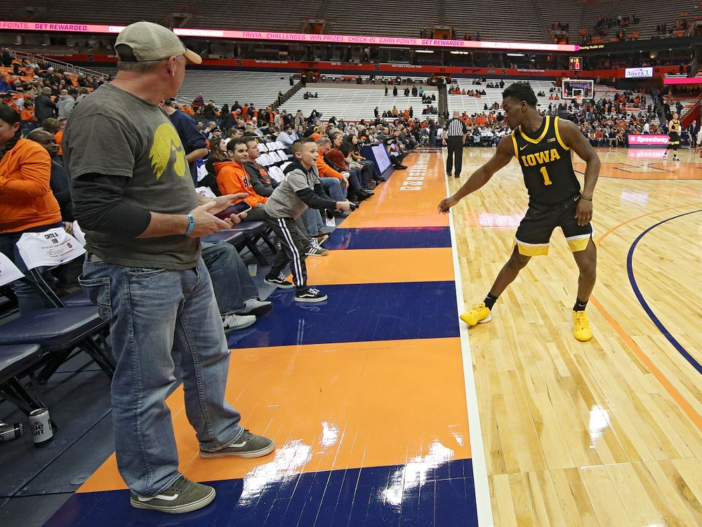 Iowa Hawkeyes guard Joe Toussaint (1) gives his sleeve to a young fan after winning their ACC/Big Ten Challenge game at the Carrier Dome in Syracuse, N.Y. on Tuesday, Dec 3, 2019. (Stephen Mally/hawkeyesports.com)