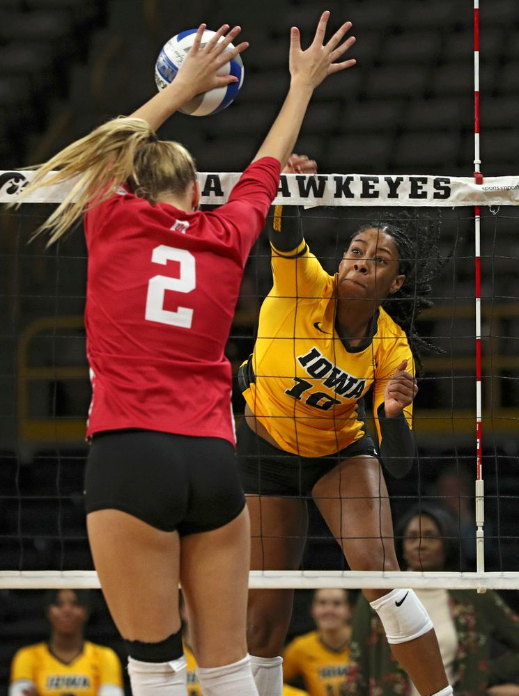 Iowa's Griere Hughes (10) gets a kill during their match at Carver-Hawkeye Arena in Iowa City on Sunday, Oct 20, 2019. (Stephen Mally/hawkeyesports.com)
