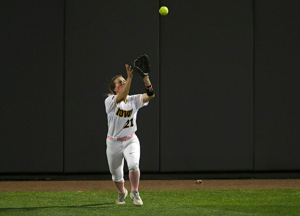 Iowa center fielder Havyn Monteer (21) pulls in a fly ball for an out during the seventh inning of their game against Iowa State at Pearl Field in Iowa City on Tuesday, Apr. 9, 2019. (Stephen Mally/hawkeyesports.com)