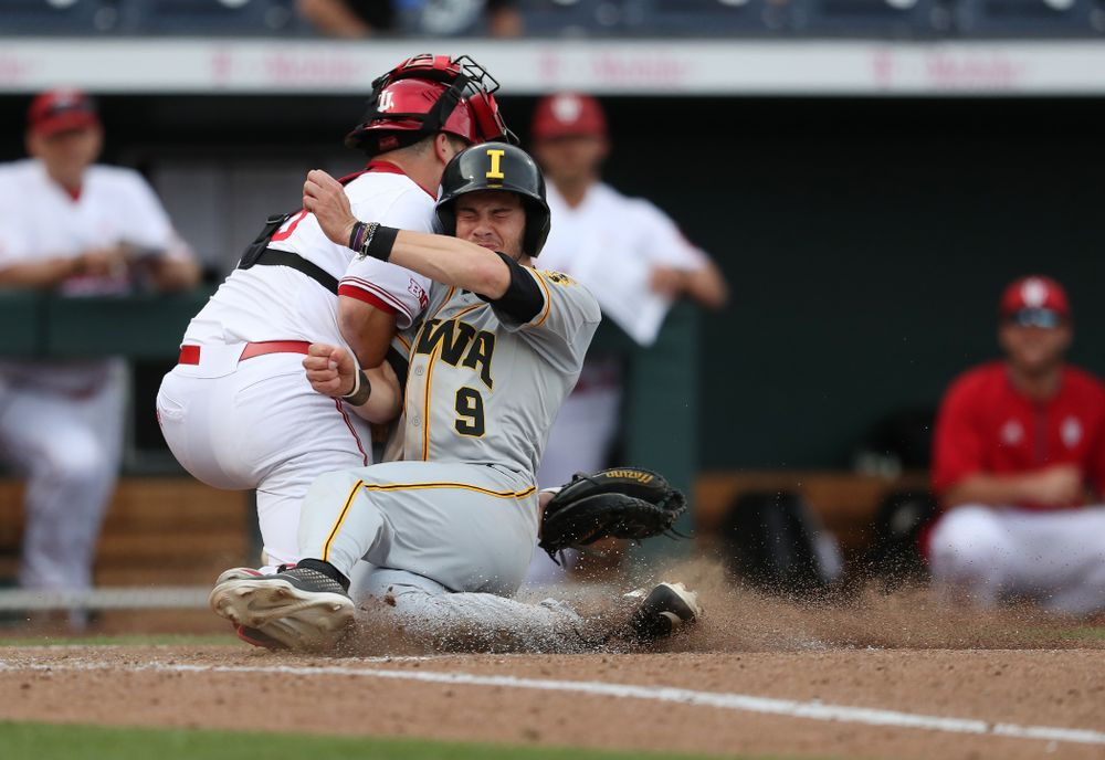 Iowa Hawkeyes outfielder Ben Norman (9) scores against the Indiana Hoosiers in the first round of the Big Ten Baseball Tournament Wednesday, May 22, 2019 at TD Ameritrade Park in Omaha, Neb. (Brian Ray/hawkeyesports.com)