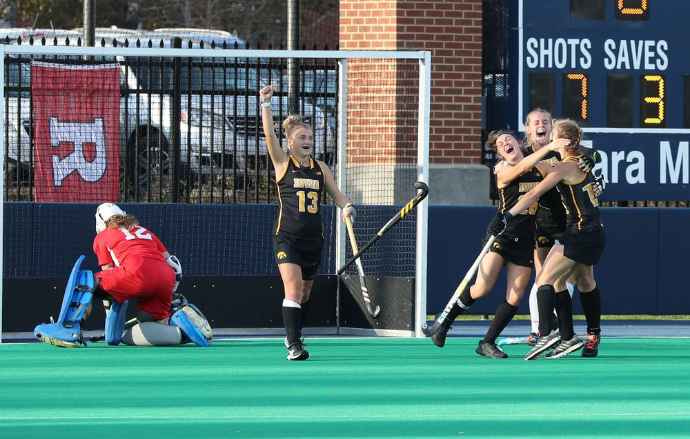 Iowa Hawkeyes forward Maddy Murphy (26), Katie Birch (11), Esme Gibson (15), and forward Leah Zellner (13) celebrate their game winning goal against Penn State in the 2019 Big Ten Field Hockey Tournament Championship Game Sunday, November 10, 2019 in State College. (Brian Ray/hawkeyesports.com)