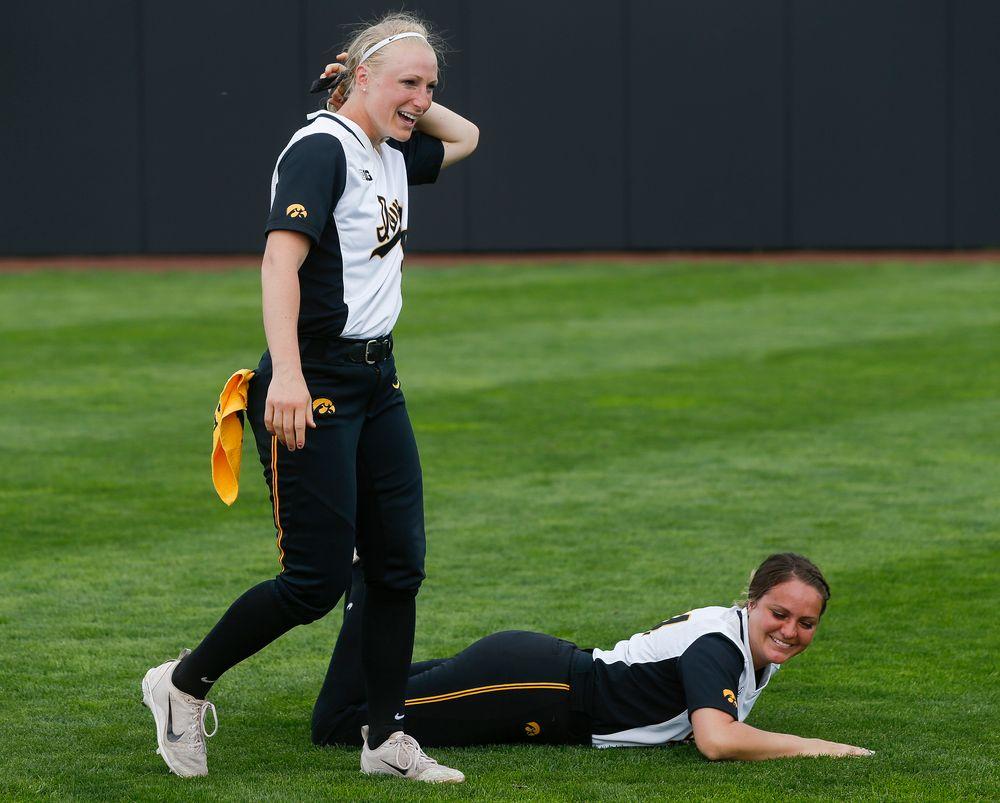 Iowa Hawkeyes infielder Sarah Kurtz (9), Iowa Hawkeyes catcher Daniela Chambers (44)