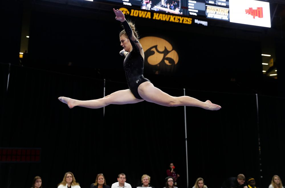 Iowa's Sydney Hogan competes on the beam