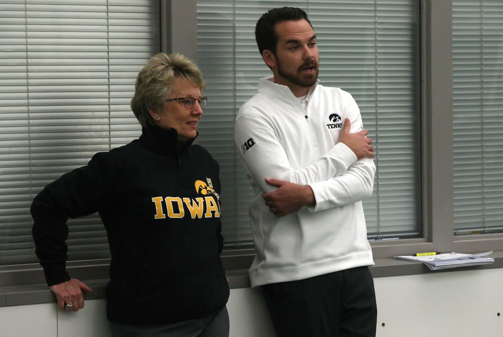 Iowa Hawkeyes Head Coach Ross Wilson talks with Deputy Athletics Director Barbara Burke before their match against the Butler Bulldogs Sunday, January 27, 2019 at the Hawkeye Tennis and Recreation Complex. (Brian Ray/hawkeyesports.com)