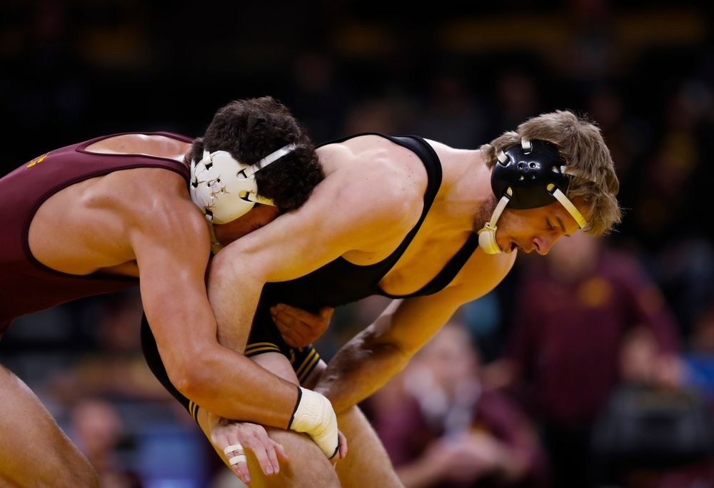 Iowa's Mitch Bowman wrestles Minnesota's Brandon Krone at 184 pounds