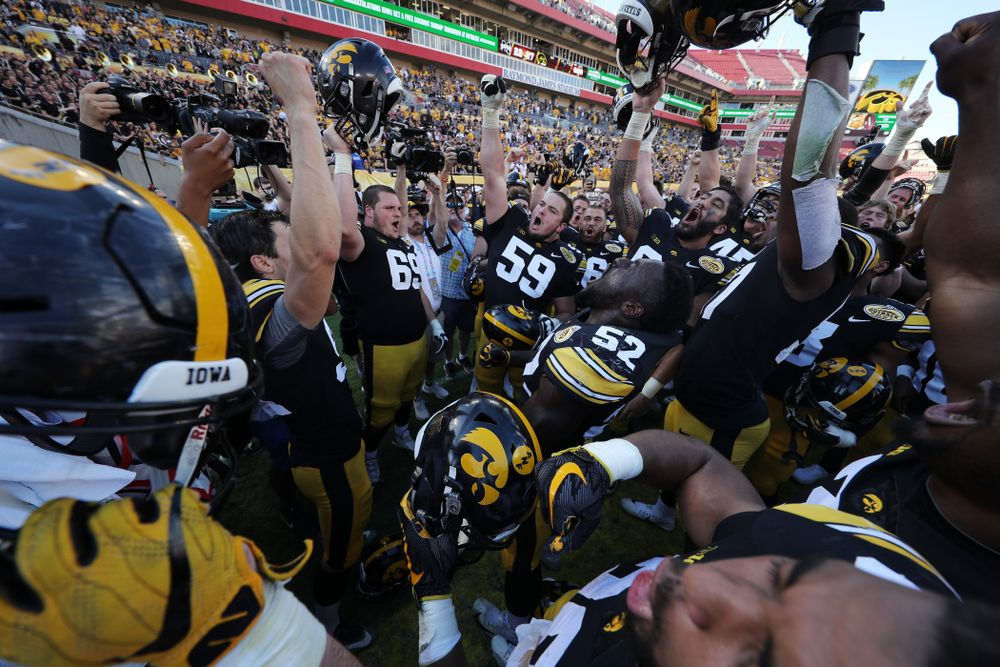 The Iowa Hawkeyes sing the Fight Song following the Outback Bowl Tuesday, January 1, 2019 at Raymond James Stadium in Tampa, FL. (Brian Ray/hawkeyesports.com)