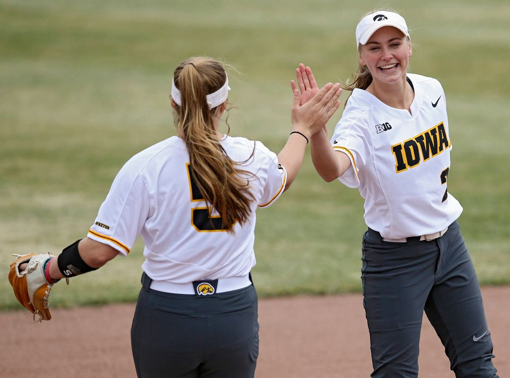 Iowa Hawkeyes Sydney Owens (5) gets a high-five from Aralee Bogar (2) as she takes the field before their Big Ten Conference softball game at Pearl Field in Iowa City on Friday, Mar. 29, 2019. (Stephen Mally/hawkeyesports.com)