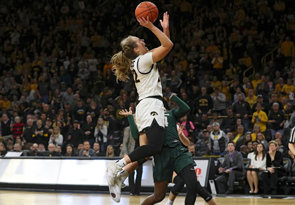 Iowa Hawkeyes guard Kathleen Doyle (22) scores a basket while being fouled during the fourth quarter of their game at Carver-Hawkeye Arena in Iowa City on Sunday, January 26, 2020. (Stephen Mally/hawkeyesports.com)