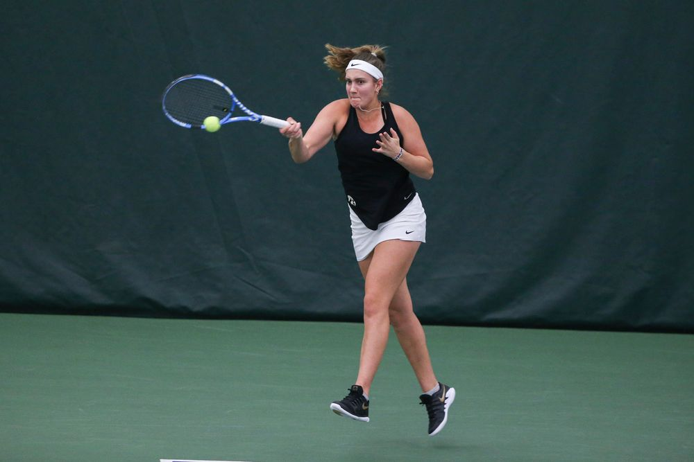 Iowa's Ashleigh Jacobs returns a hit during the Iowa women's tennis meet vs DePaul  on Friday, February 21, 2020 at the Hawkeye Tennis and Recreation Complex. (Lily Smith/hawkeyesports.com)
