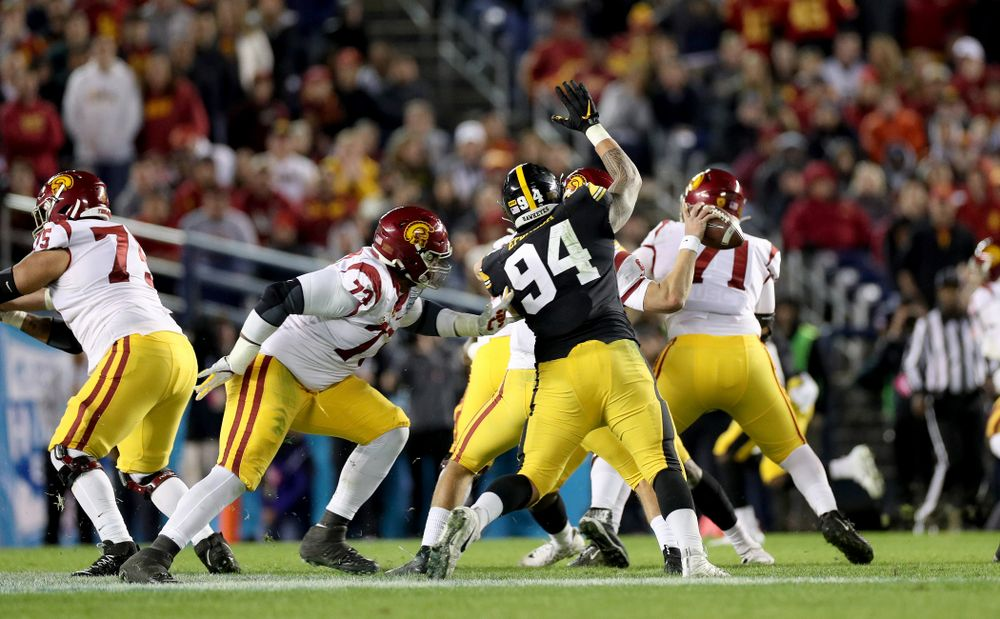 Iowa Hawkeyes defensive end A.J. Epenesa (94) causes a fumble against USC in the Holiday Bowl Friday, December 27, 2019 at San Diego Community Credit Union Stadium.  (Brian Ray/hawkeyesports.com)