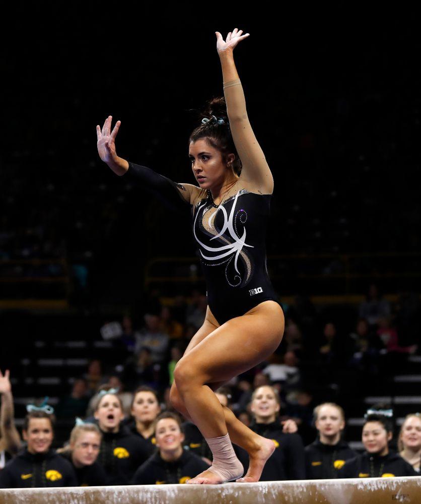 Iowa's Nikki Youd competes on the beam against the Nebraska Cornhuskers