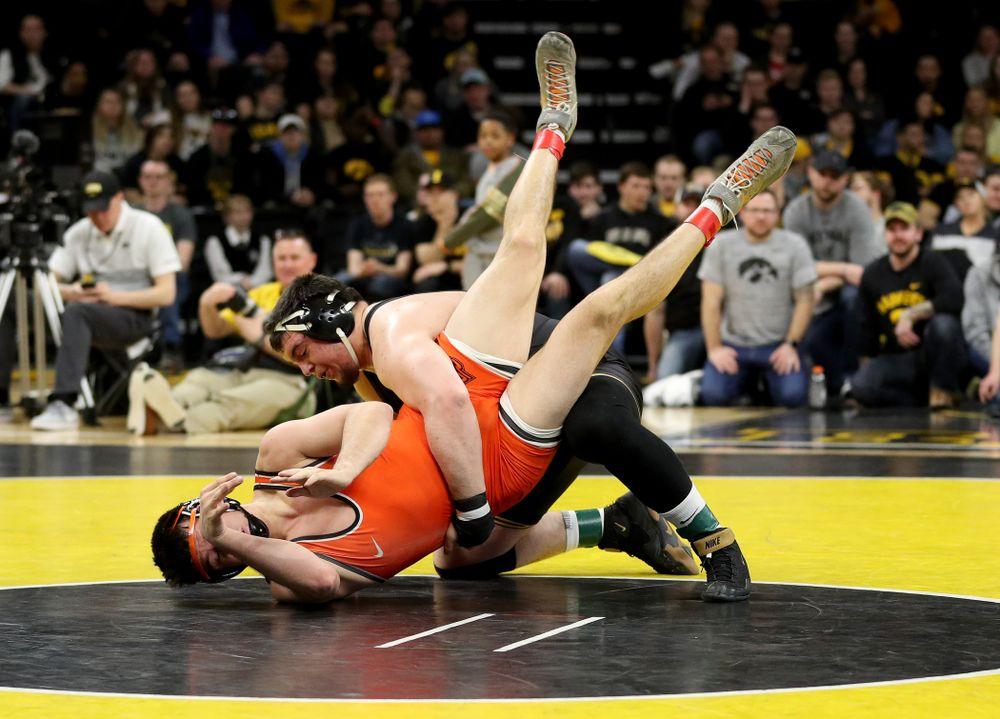 Iowa's Tony Cassioppi wrestles Oklahoma State's Auston Harris at heavyweight Sunday, February 23, 2020 at Carver-Hawkeye Arena. Cassioppi won the match 11-1. (Brian Ray/hawkeyesports.com)