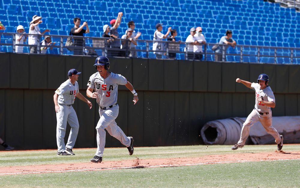 Matt Hoeg (3) and infielder Kyle Crowl (23)