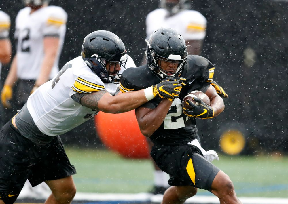 Iowa Hawkeyes defensive end A.J. Epenesa (94) and running back Ivory Kelly-Martin (21) during camp practice No. 15  Monday, August 20, 2018 at the Hansen Football Performance Center. (Brian Ray/hawkeyesports.com)