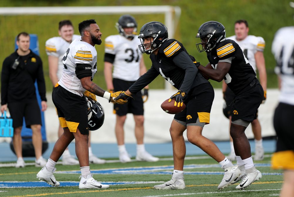 Iowa Hawkeyes linebacker Djimon Colbert (32) and wide receiver Desmond Hutson (81) during Holiday Bowl Practice No. 3  Tuesday, December 24, 2019 at San Diego Mesa College. (Brian Ray/hawkeyesports.com)