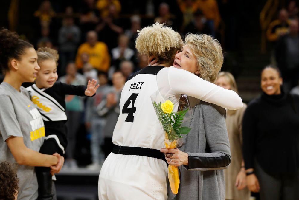 Iowa Hawkeyes forward Chase Coley (4) and head coach Lisa Bluder