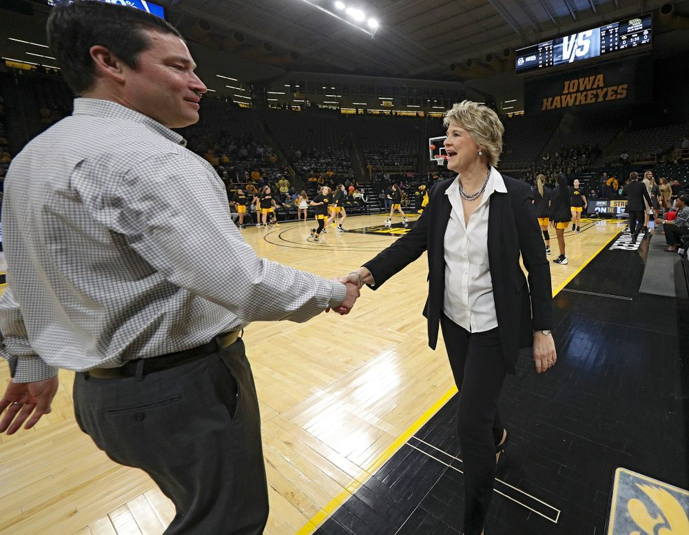 Ohio State Buckeyes head coach Kevin McGuff (from left) shakes hands with Iowa Hawkeyes head coach Lisa Bluder before their game at Carver-Hawkeye Arena in Iowa City on Thursday, January 23, 2020. (Stephen Mally/hawkeyesports.com)