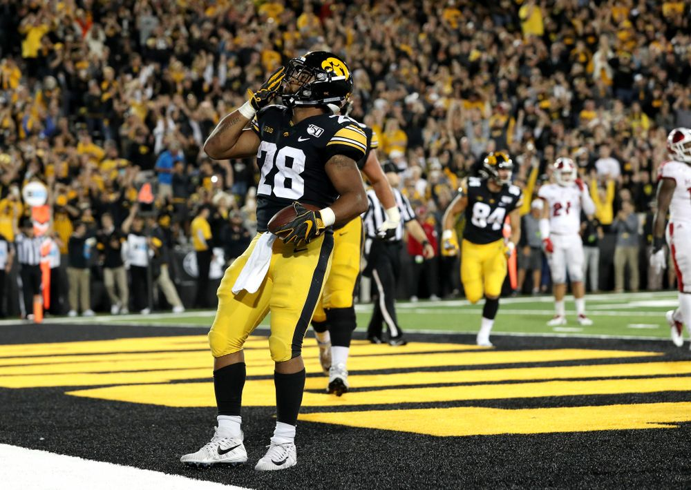 Iowa Hawkeyes running back Toren Young (28) celebrates a touchdown against the Miami RedHawks Saturday, August 31, 2019 at Kinnick Stadium in Iowa City. (Brian Ray/hawkeyesports.com)
