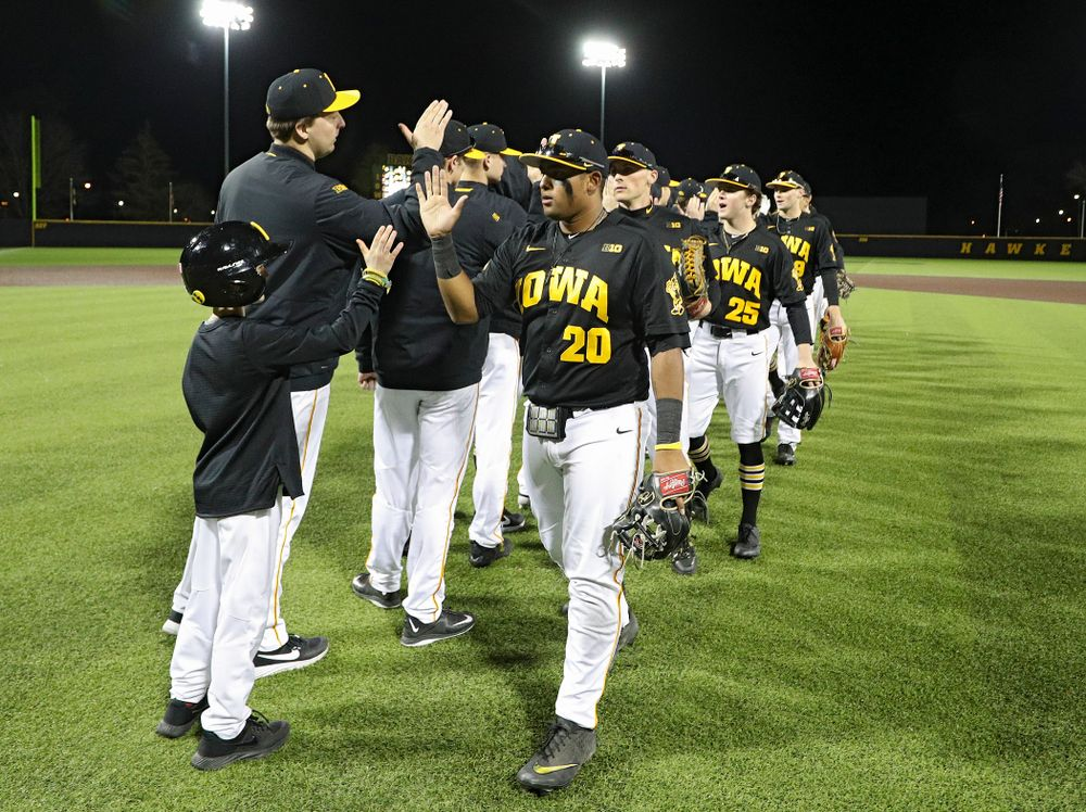 The Hawkeyes celebrate after winning their game at Duane Banks Field in Iowa City on Tuesday, March 3, 2020. (Stephen Mally/hawkeyesports.com)