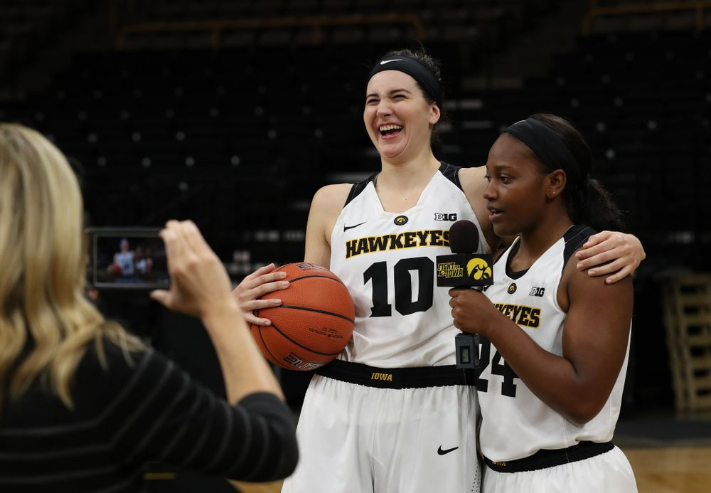 Iowa Hawkeyes guard Zion Sanders (24) interviews forward Megan Gustafson (10) for a Facebook Live during the team's annual media day Wednesday, October 31, 2018 at Carver-Hawkeye Arena. (Brian Ray/hawkeyesports.com)