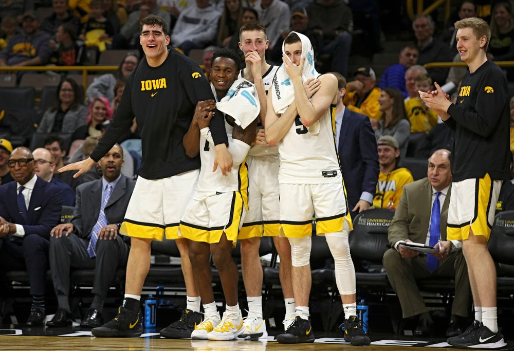 Iowa Hawkeyes center Luka Garza (55), guard Joe Toussaint (1), guard Joe Wieskamp (10), and guard CJ Fredrick (5) react after forward Riley Till (not pictured) was fouled as he tried to dunk over Kennesaw State Owls forward Bryson Lockley (not pictured) during the second half of their their game at Carver-Hawkeye Arena in Iowa City on Sunday, December 29, 2019. (Stephen Mally/hawkeyesports.com)