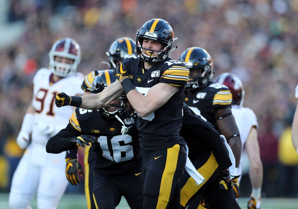 Iowa Hawkeyes wide receiver Henry Marchese (13) celebrates after making a stop on special teams against the Minnesota Golden Gophers Saturday, November 16, 2019 at Kinnick Stadium. (Brian Ray/hawkeyesports.com)