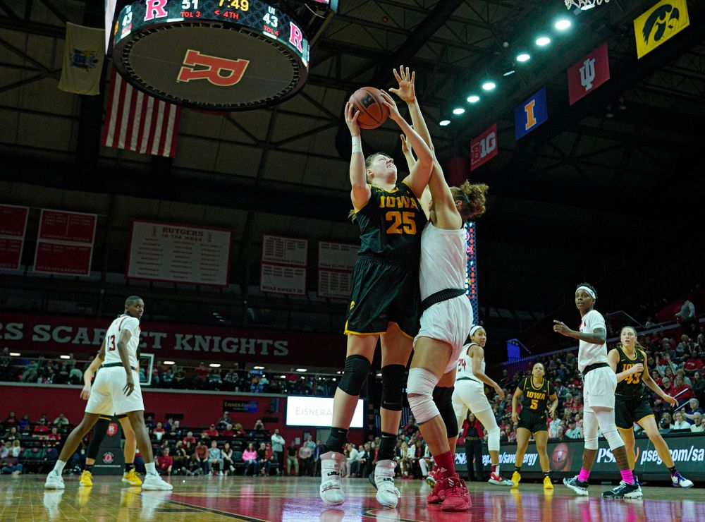 Iowa forward/center Monika Czinano (25) scores a basket during the fourth quarter of their game at the Rutgers Athletic Center in Piscataway, N.J. on Sunday, March 1, 2020. (Stephen Mally/hawkeyesports.com)