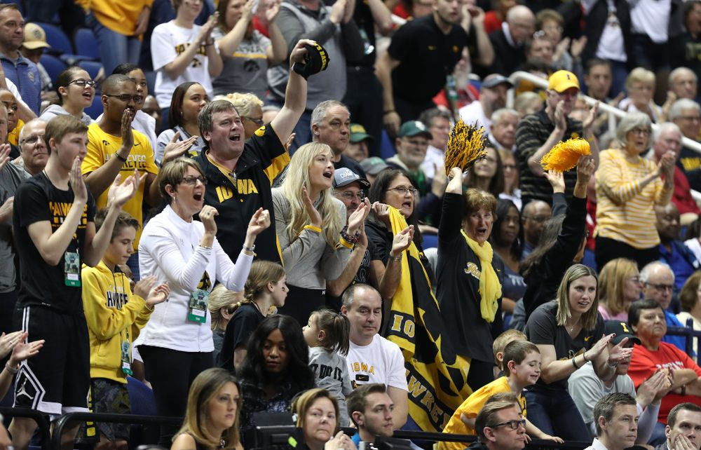 Fans cheer on the Iowa Hawkeyes against the NC State Wolfpack in the regional semi-final of the 2019 NCAA Women's College Basketball Tournament Saturday, March 30, 2019 at Greensboro Coliseum in Greensboro, NC.(Brian Ray/hawkeyesports.com)