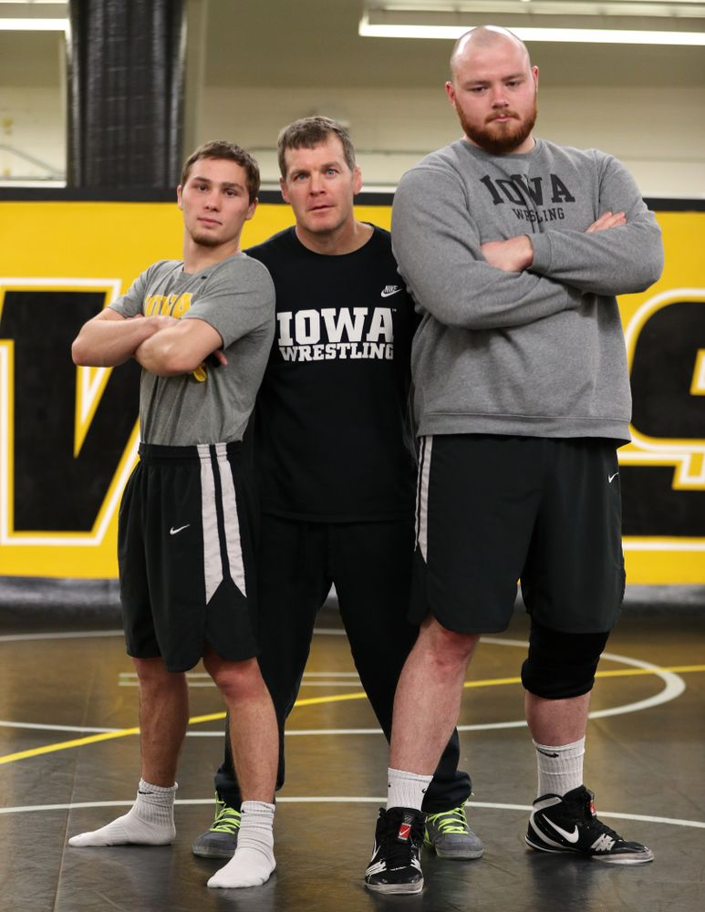 Iowa Hawkeyes head coach Tom Brands poses with Spencer Lee and Sam Stoll during the team's annual media day Monday, November 5, 2018 at Carver-Hawkeye Arena. (Brian Ray/hawkeyesports.com)