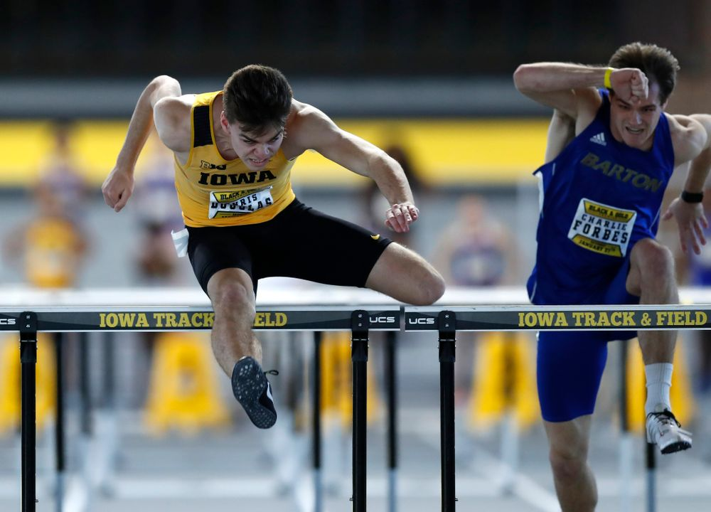Chris Douglas competes in 60 meter high hurdles