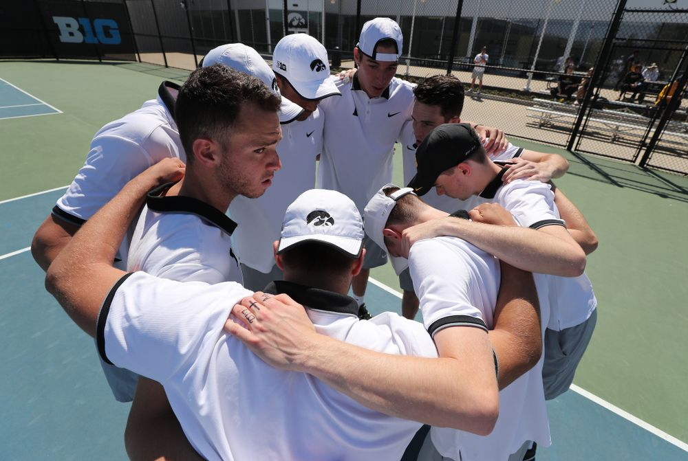 IowaÕs Jonas Larsen pumps up his teammates before their game against the Michigan Wolverines Sunday, April 21, 2019 at the Hawkeye Tennis and Recreation Complex. (Brian Ray/hawkeyesports.com)