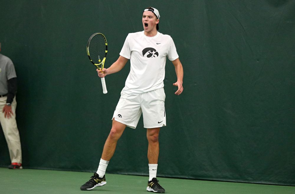 Iowa's Joe Tyler celebrates after winning his singles match at the Hawkeye Tennis and Recreation Complex in Iowa City on Sunday, February 16, 2020. (Stephen Mally/hawkeyesports.com)