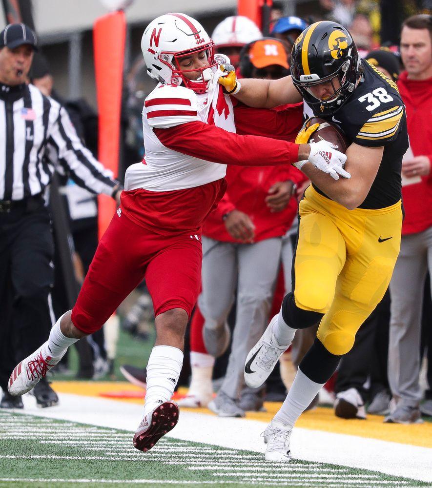 Iowa Hawkeyes tight end T.J. Hockenson (38) runs the ball during a game against Nebraska at Kinnick Stadium on November 23, 2018. (Tork Mason/hawkeyesports.com)