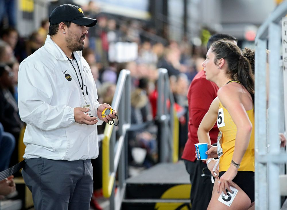 Iowa assistant coach/recruiting coordinator Jason Wakenight (from left) talks with Mallory King and Tia Saunders after they ran the women's 400 meter dash event during the Larry Wieczorek Invitational at the Recreation Building in Iowa City on Saturday, January 18, 2020. (Stephen Mally/hawkeyesports.com)