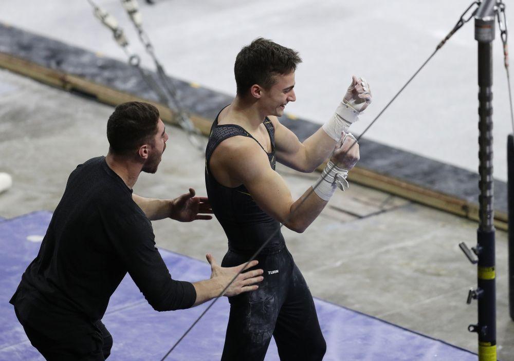 Iowa's Mitch Mandozzi competes on the high bar against Oklahoma Saturday, February 9, 2019 at Carver-Hawkeye Arena. (Brian Ray/hawkeyesports.com)