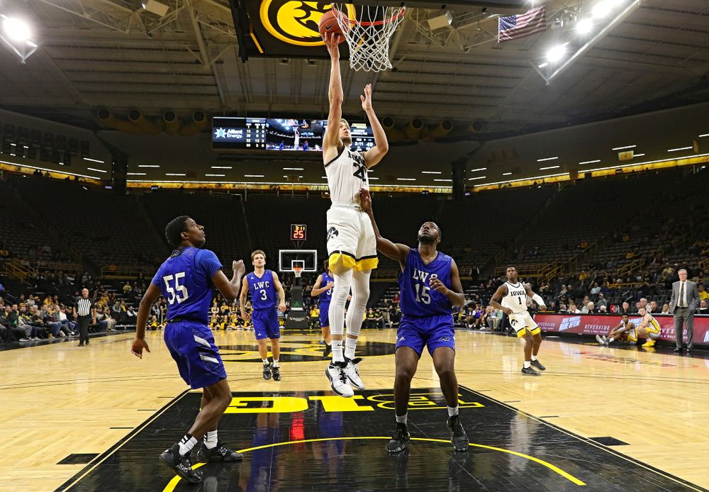 Iowa Hawkeyes forward Riley Till (20) makes a basket during the second half of their exhibition game against Lindsey Wilson College at Carver-Hawkeye Arena in Iowa City on Monday, Nov 4, 2019. (Stephen Mally/hawkeyesports.com)