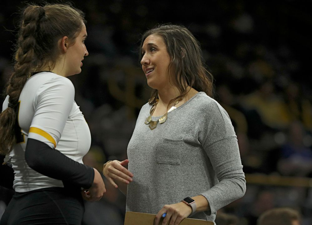 Iowa's Blythe Rients (from left) talks with assistant coach Bre Payton during the fourth set of their match at Carver-Hawkeye Arena in Iowa City on Saturday, Nov 30, 2019. (Stephen Mally/hawkeyesports.com)
