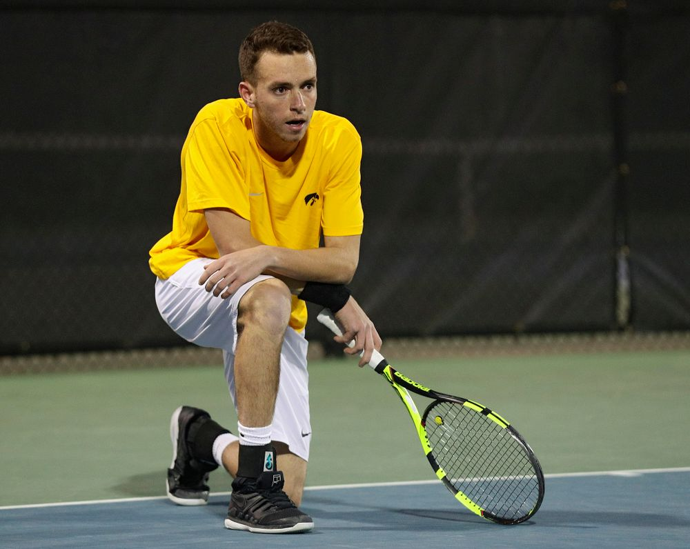 Iowa's Kareem Allaf drops to a knee after winning his match again Michigan State at the Hawkeye Tennis and Recreation Complex in Iowa City on Friday, Apr. 19, 2019. (Stephen Mally/hawkeyesports.com)