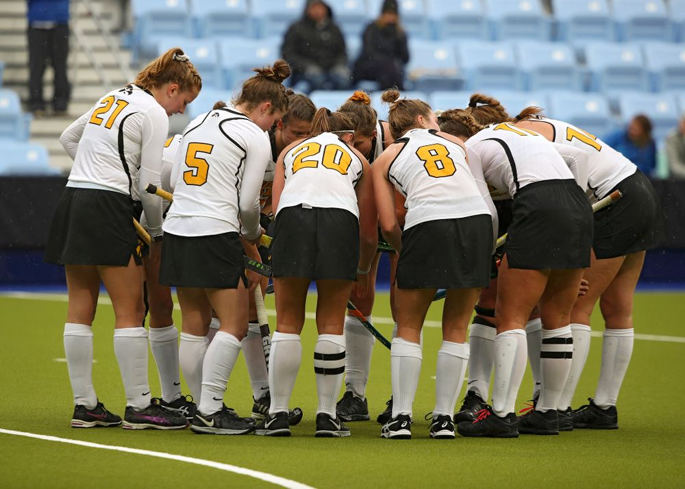The Hawkeyes huddle before a penalty corner during the second quarter of their NCAA Tournament First Round match against Duke at Karen Shelton Stadium in Chapel Hill, N.C. on Friday, Nov 15, 2019. (Stephen Mally/hawkeyesports.com)