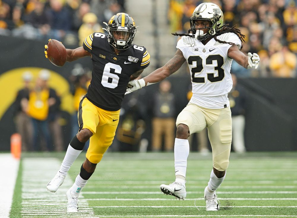Iowa Hawkeyes wide receiver Ihmir Smith-Marsette (6) runs after pulling in a pass with one hand during the first quarter of their game at Kinnick Stadium in Iowa City on Saturday, Oct 19, 2019. (Stephen Mally/hawkeyesports.com)