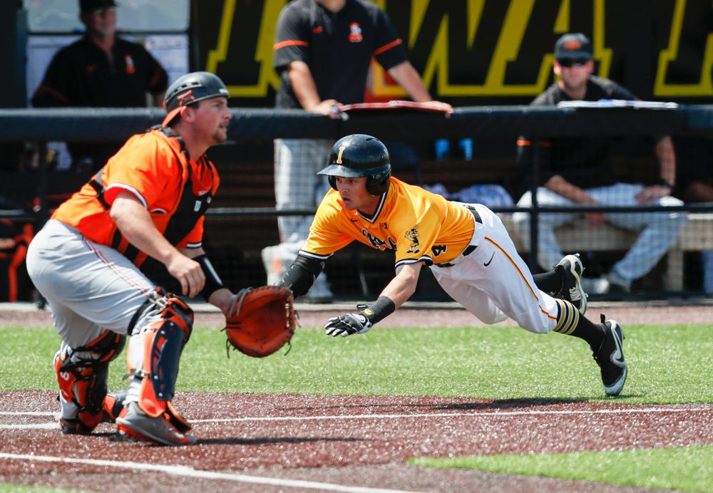Iowa Hawkeyes infielder Mitchell Boe (4) scores on an inside the park home run against the Oklahoma State Cowboys Sunday, May 6, 2018 at Duane Banks Field. (Brian Ray/hawkeyesports.com)