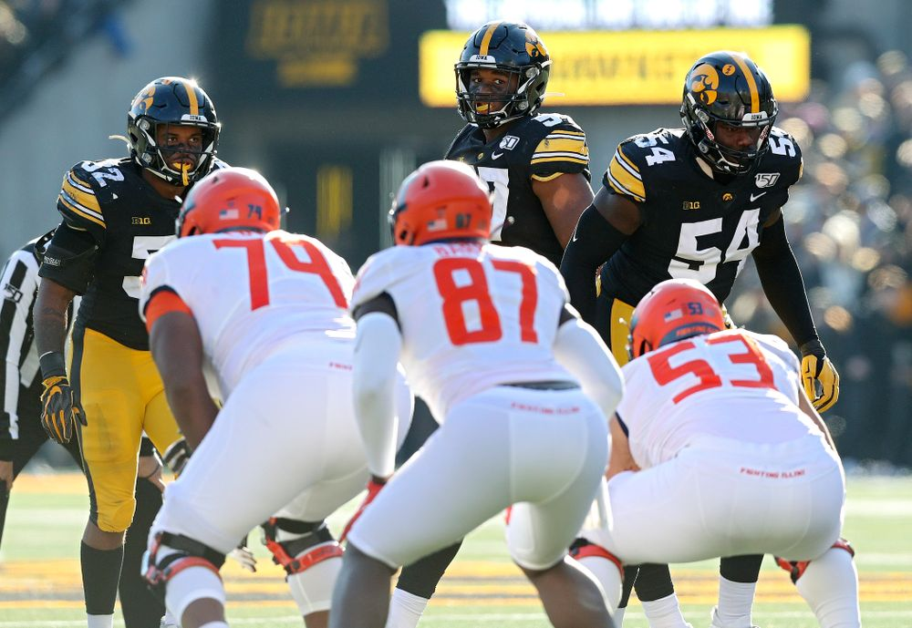 Iowa Hawkeyes linebacker Djimon Colbert (32), defensive end Chauncey Golston (57), and defensive tackle Daviyon Nixon (54) before a snap during the fourth quarter of their game at Kinnick Stadium in Iowa City on Saturday, Nov 23, 2019. (Stephen Mally/hawkeyesports.com)