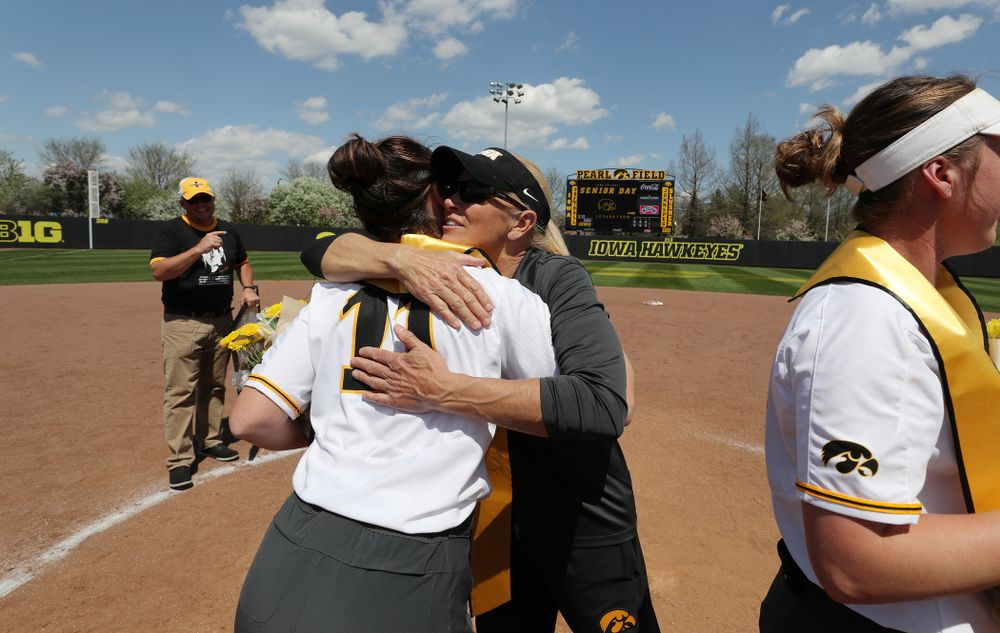 Iowa Hawkeyes Mallory Kilian (11) and Head Coach Renee Gillispie during senior day festivities following their game against the Ohio State Buckeyes Sunday, May 5, 2019 at Pearl Field. (Brian Ray/hawkeyesports.com)ic