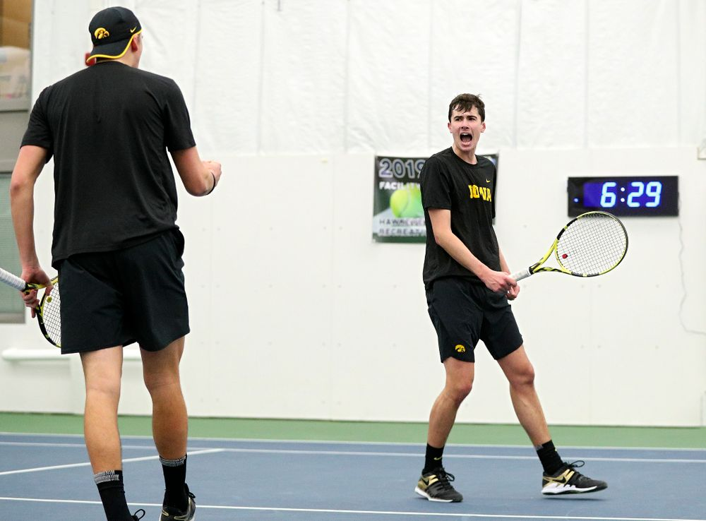 Iowa's Joe Tyler (from left) and Matt Clegg celebrate a point during their doubles match at the Hawkeye Tennis and Recreation Complex in Iowa City on Friday, February 14, 2020. (Stephen Mally/hawkeyesports.com)