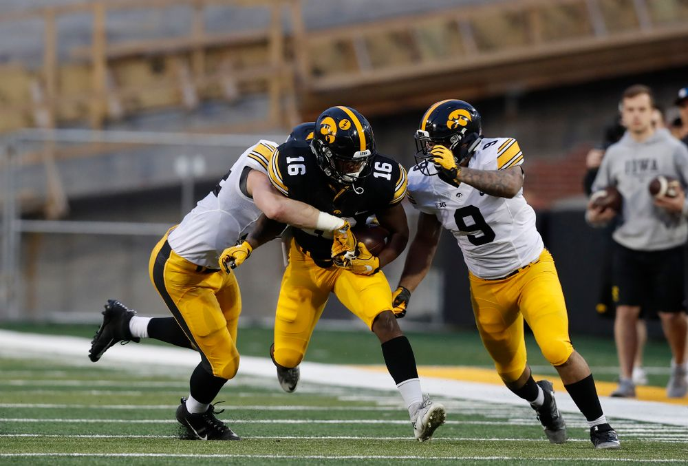 Iowa Hawkeyes running back Kyshaun Bryan (16) and defensive back Geno Stone (9) during their final spring practice Friday, April 20, 2018 at Kinnick Stadium. (Brian Ray/hawkeyesports.com)