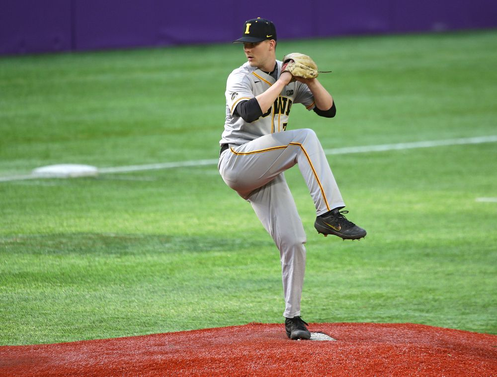 Iowa Hawkeyes pitcher Cam Baumann (35) delivers to the plate during the eighth inning of their CambriaCollegeClassic game at U.S. Bank Stadium in Minneapolis, Minn. on Friday, February 28, 2020. (Stephen Mally/hawkeyesports.com)