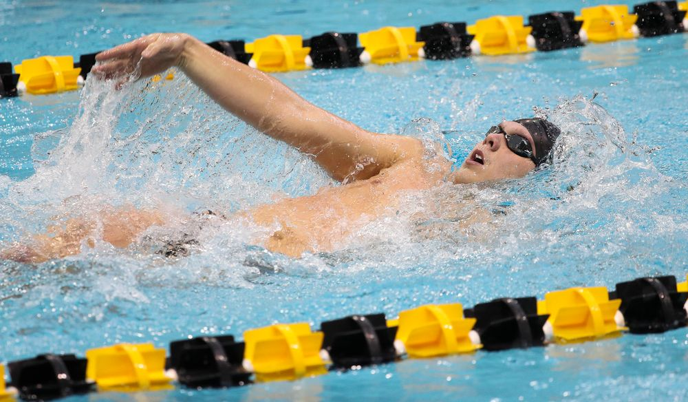 Iowa's Forrest White competes in the 200-yard backstroke during a meet against Michigan and Denver at the Campus Recreation and Wellness Center on November 3, 2018. (Tork Mason/hawkeyesports.com)