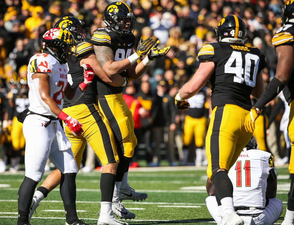 Iowa Hawkeyes defensive end Anthony Nelson (98) and Iowa Hawkeyes defensive end A.J. Epenesa (94) react after Epenesa's sack during a game against Maryland at Kinnick Stadium on October 20, 2018. (Tork Mason/hawkeyesports.com)