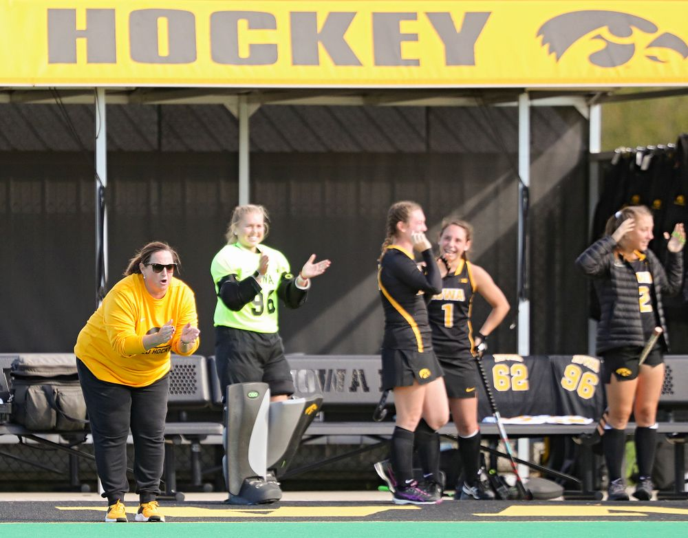 Iowa's head coach Lisa Cellucci claps after her team scored a goal during the third quarter of their match at Grant Field in Iowa City on Friday, Oct 4, 2019. (Stephen Mally/hawkeyesports.com)