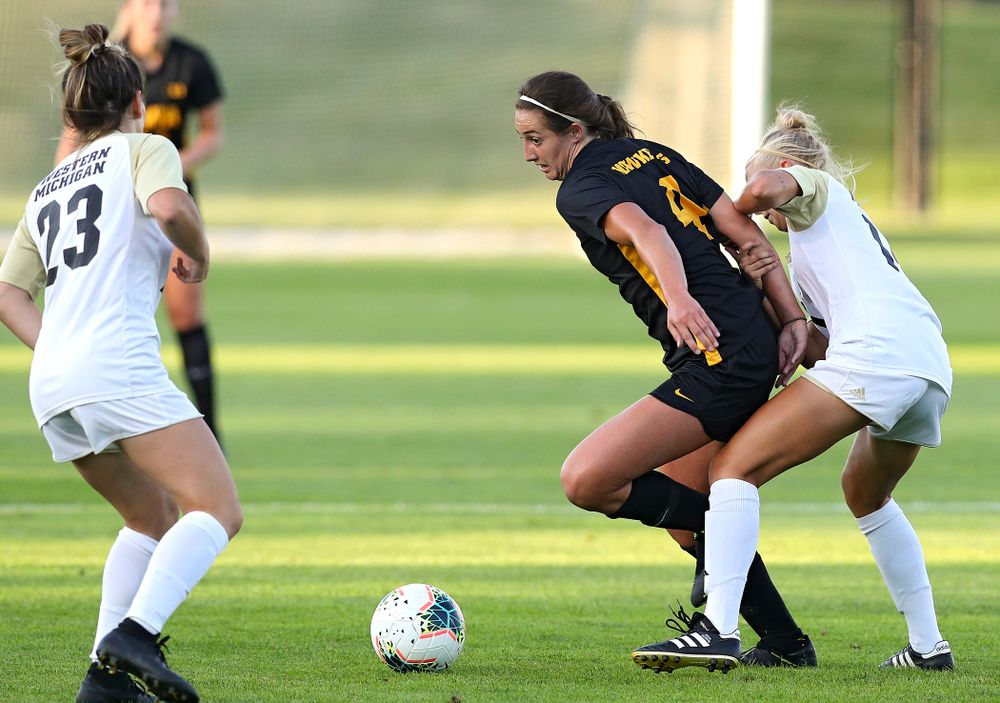 Iowa forward Kaleigh Haus (4) tries to move between two defenders during the first half of their match against Western Michigan at the Iowa Soccer Complex in Iowa City on Thursday, Aug 22, 2019. (Stephen Mally/hawkeyesports.com)